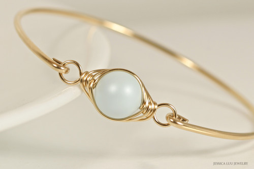 14k yellow gold filled wire wrapped bangle bracelet with pastel light blue Swarovski pearl handmade by Jessica Luu Jewelry