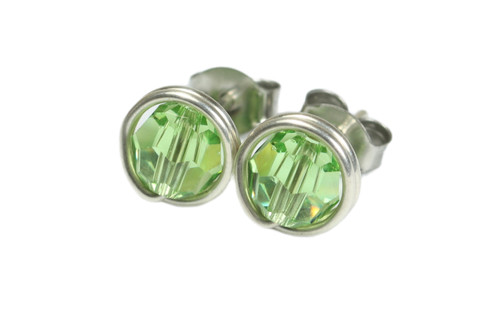 Sterling silver wire wrapped light green peridot crystal round stud earrings handmade by Jessica Luu Jewelry