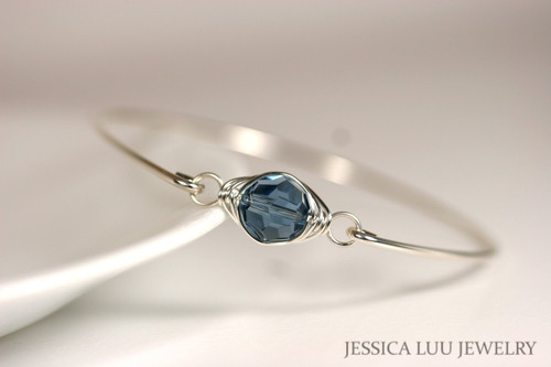 Sterling silver wire wrapped bangle bracelet with denim blue Swarovski crystal handmade by Jessica Luu Jewelry