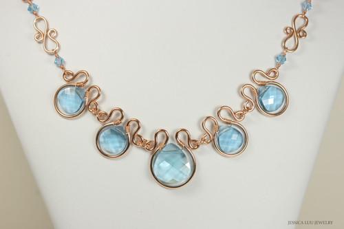 14K rose gold filled wire wrapped aquamarine blue Swarovski crystal flat briolette statement necklace handmade by Jessica Luu Jewelry