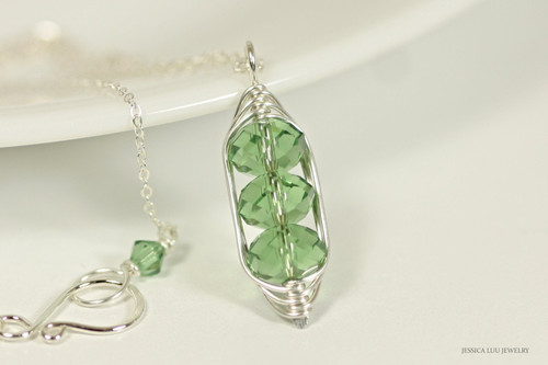 Sterling silver wire wrapped three stone pendant on chain necklace with erinite green Swarovski crystals handmade by Jessica Luu Jewelry