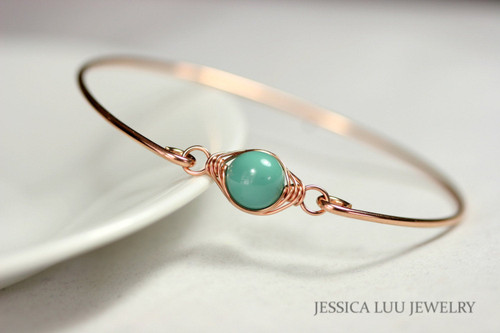 14k rose gold filled wire wrapped bangle bracelet with jade green Swarovski pearl handmade by Jessica Luu Jewelry