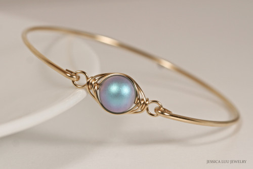 14K yellow gold filled wire wrapped bangle bracelet with iridescent light blue Swarovski pearl handmade by Jessica Luu Jewelry