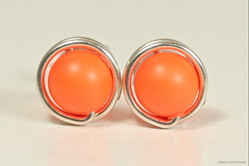 Sterling silver wire wrapped stud earrings with neon orange Swarovski pearls handmade by Jessica Luu Jewelry