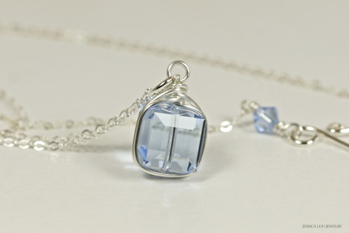 Sterling silver wire wrapped light sapphire blue Swarovski crystal cube pendant on chain necklace handmade by Jessica Luu Jewelry