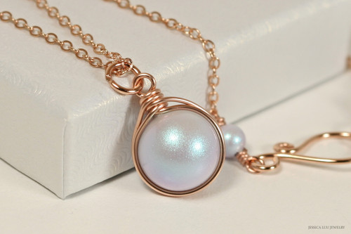 14K rose gold filled wire wrapped iridescent light dreamy blue Swarovski pearl solitaire pendant on chain necklace handmade by Jessica Luu Jewelry