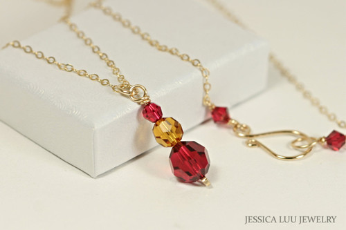 14K yellow gold filled wire wrapped orange topaz and scarlet red Swarovski crystal pendant on chain necklace handmade by Jessica Luu Jewelry