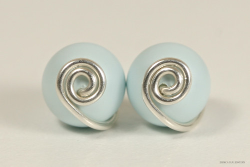 Sterling silver wire wrapped pastel light blue Swarovski pearl stud earrings handmade by Jessica Luu Jewelry