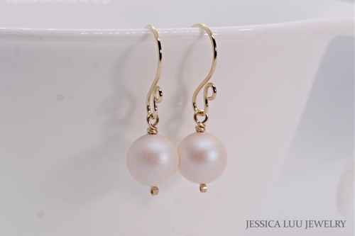 14K yellow gold filled wire wrapped pearlescent white Swarovski pearl dangle earrings handmade by Jessica Luu Jewelry