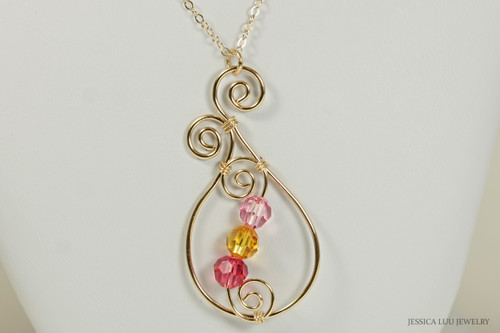 14K yellow gold filled wire wrapped paisley pendant on chain necklace with light rose, sunflower, and Indian pink Swarovski crystals handmade by Jessica Luu Jewelry