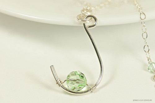Sterling silver fish hook pendant on chain necklace with chrysolite light green Swarovski crystal solitaire handmade by Jessica Luu Jewelry
