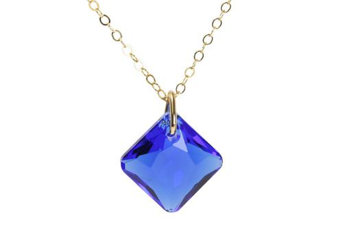 14K yellow gold filled chain necklace with majestic blue Swarovski crystal pendant handmade by Jessica Luu Jewelry
