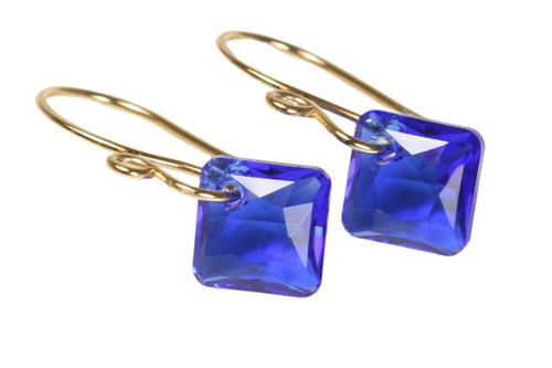 14K gold filled earrings with majestic blue Swarovski crystal dangles handmade by Jessica Luu Jewelry