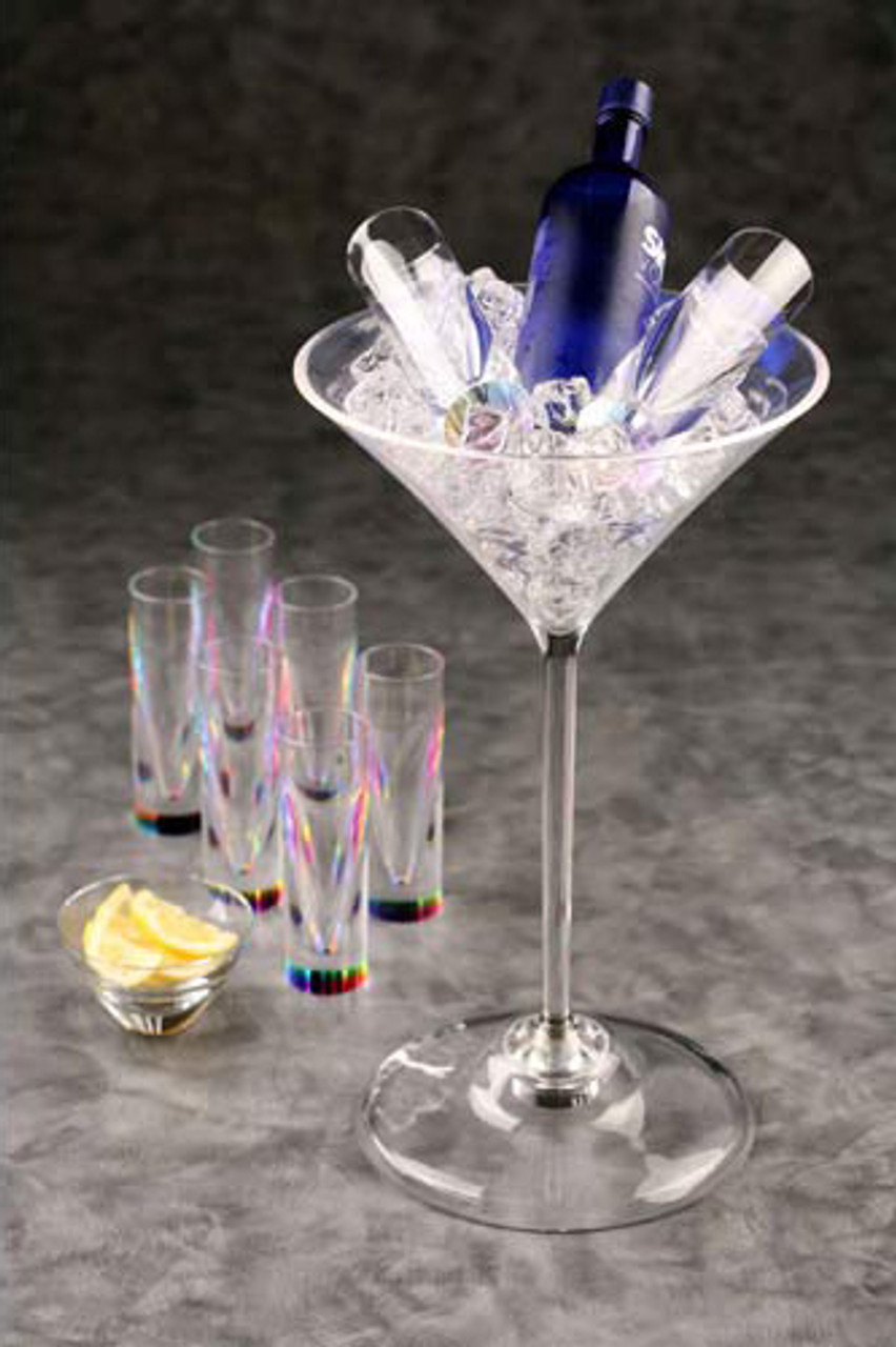 """Big, huge, jumbo, Martini, Large, jumbo, Cup, glass, Acrylic, molded, The Giant Martini Glass Chiller. DescriptionLifetime Guarantee Giving new meaning to the term """"holding one's liquor"""", this 36"""" tall Martini glass keeps up to four bottles of spirits and wine chilled and within easy reach. Skillfully crafted from high-quality 3/16"""" acrylic, it resembles fine crystal, but insulates better than glass or metal, so beverages stay cool longer with less condensation, and it won't shatter, dent or become tipsy, even when fully loaded. The chiller is food-safe and can be used as a floor-standing bowl for party snacks or fruits, or as a punch bowl. Hand wash with mild soap and water. 36"""" H x 19"""" Diam. (16 lbs.)"""