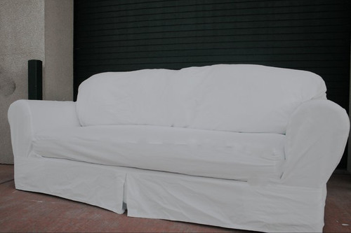 Actual slipcovered ugly sofa. This is what they look like, no catalog photo magic here.