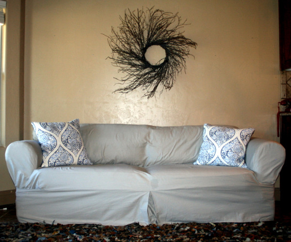 Tailored Square Cushion slipcover with accent pillows.