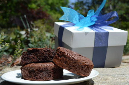 A bold color gift box of rich, creamy, gourmet chocolate brownies.