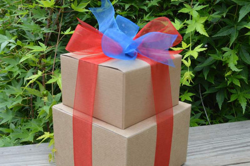 This gift tower can be customized with your choice of ribbons and white or kraft boxes.  Inside, the recipient will delight in tasting our gourmet cookies and dark chocolate brownies.