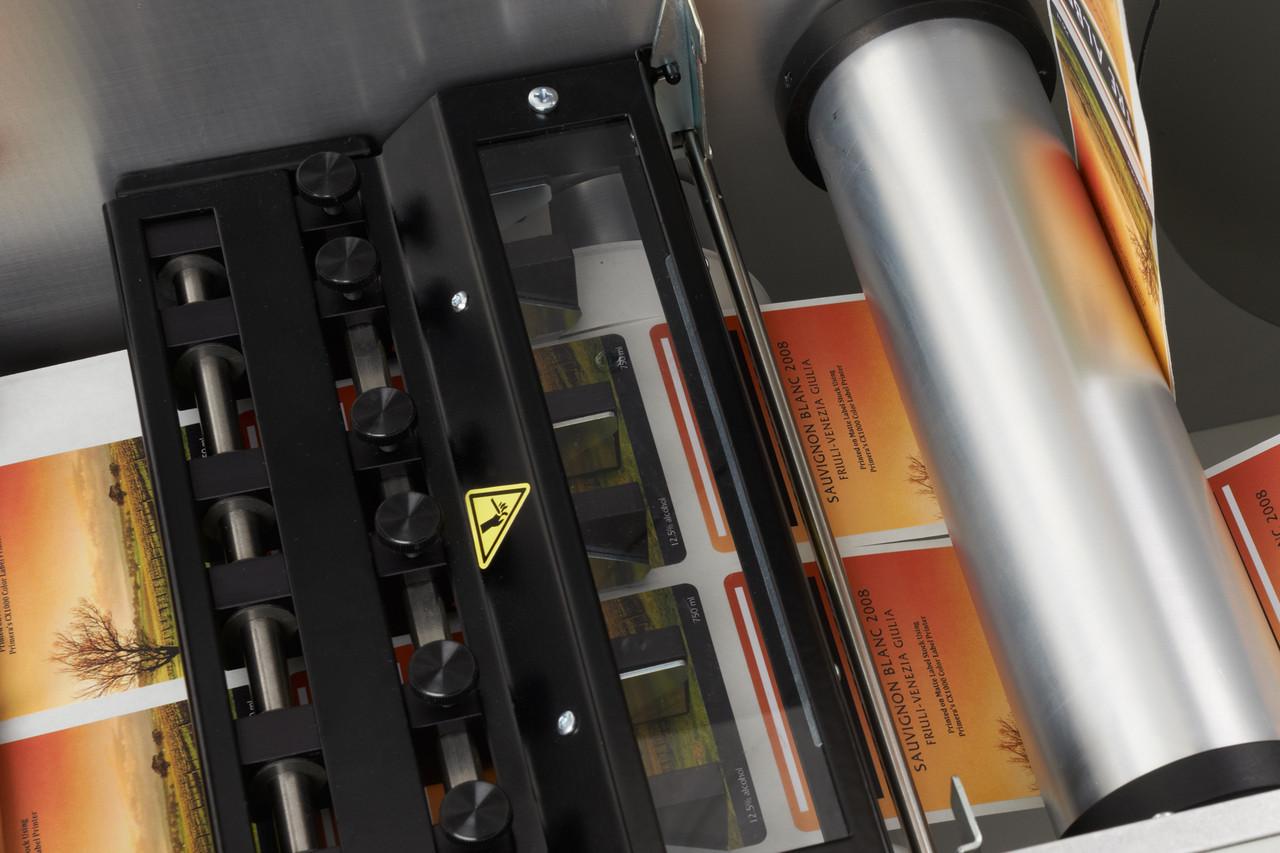 Slitting on the Primera FX1000 matrix removal system dual take-up mandrels