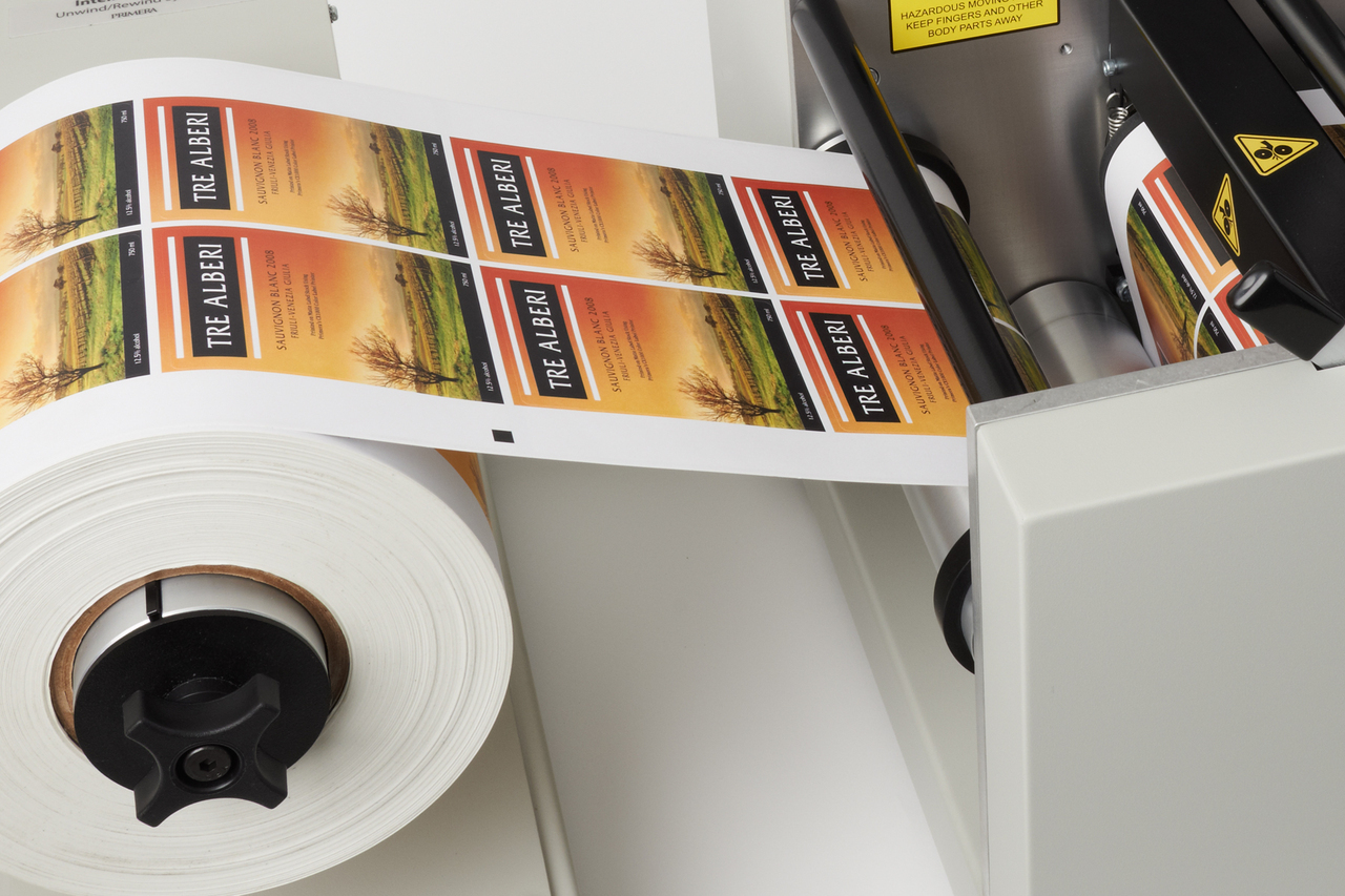 Printed label rolls on the Primera FX1000 matrix removal system dual take-up mandrels