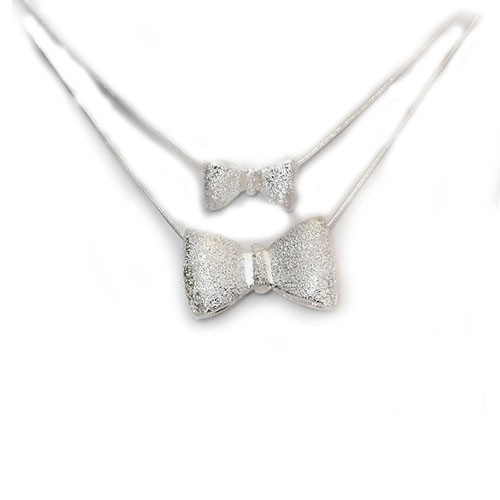 Sterling Silver Bow Tie Pendant with Free 20 Inch Chain!