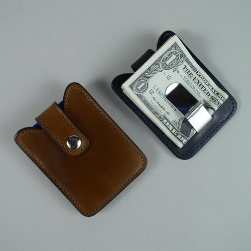 Money clip on back holds both Canadian and American bills.