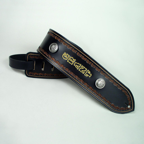 Personalized bass strap with embossed design accenting the side of the leather strap.