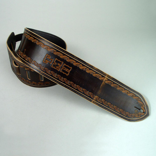 Personalized guitar strap with natural undyed letters.