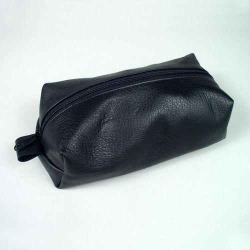 Black leather toiletry bag for men or women.