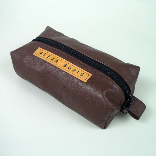 Personalized womens travel toiletry bag made with soft burgundy leather. Great travel size for men or women.