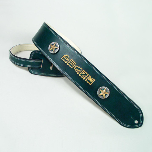 Gold lettering embossed on green leather guitar strap.