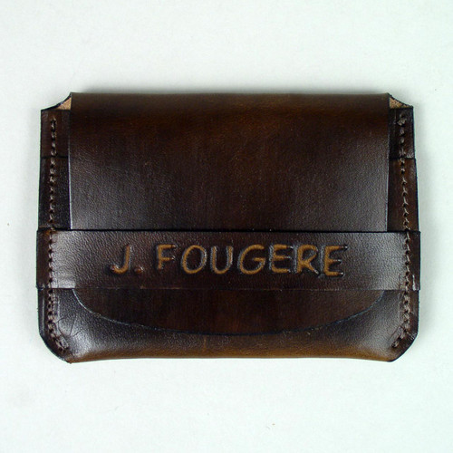 Name etched in leather credit card case. This lettering is undyed for easier reading.