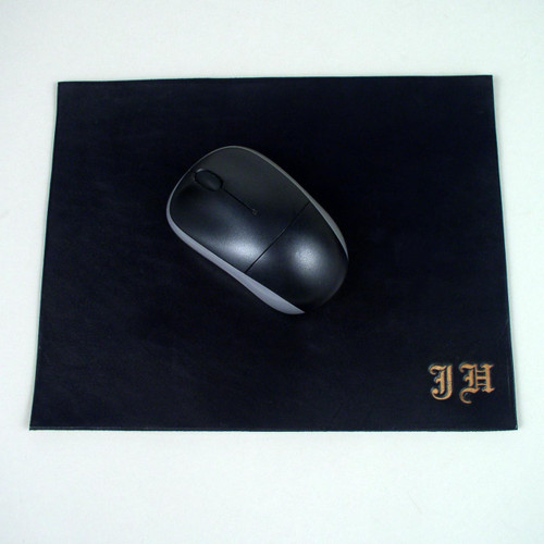 Leather mouse pad with embossed initials.