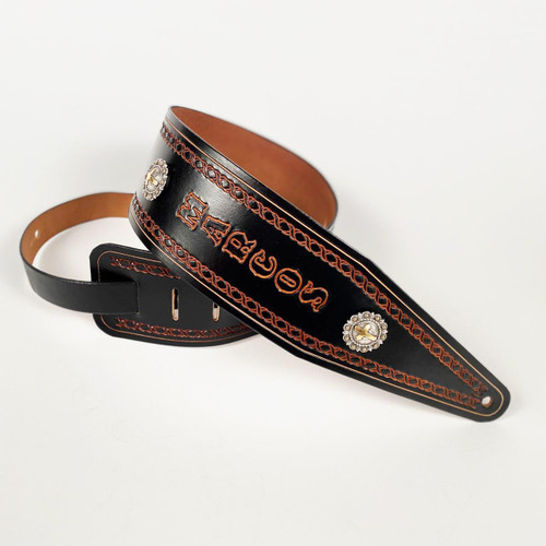 Full grain leather personalized bass strap with a tapered point. The underneath side is unlined.
