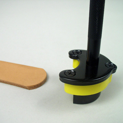 This rounded strap end punch easily cuts the shape end of a leather belt, strap or strip.