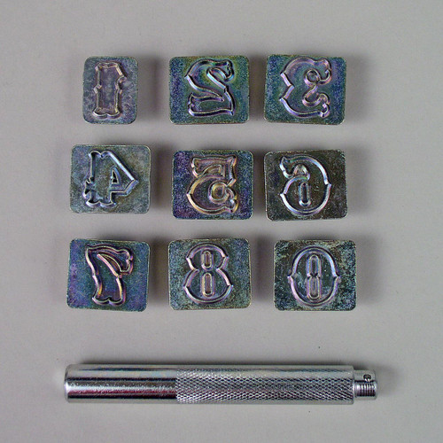 The 3/4 inch number stamp set includes numbers 0-9 and a stamp handle.