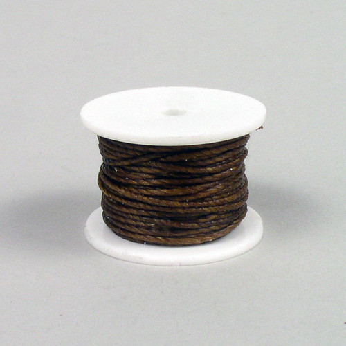 Brown sewing awl thread reel for sewing awls  that hold a thread reel or for hand sewing with harness needles.