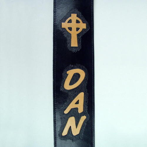 Natural undyed imprinted cross on personalized leather guitar strap.