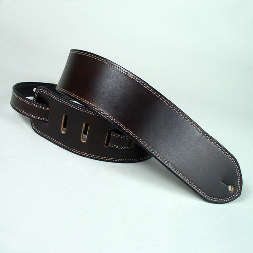 Brown leather guitar strap with beige stitching.