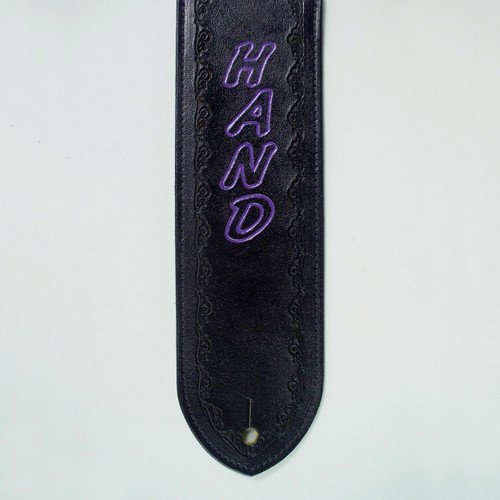Your name is etched into this personalized guitar strap  with an embossed pattern following the edge of the leather.