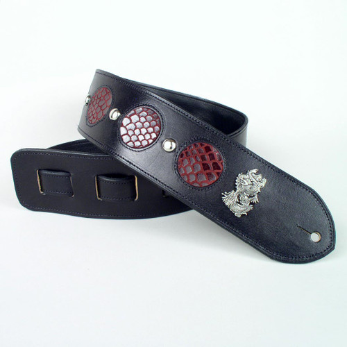 Your unique guitar strap has circular leather inlays.