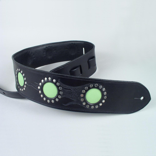 This full grain cowhide guitar strap has a green goatskin inlay encircled by small rivets.