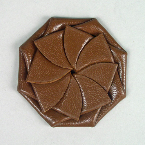 Man's leather folding coin purse in russet color.