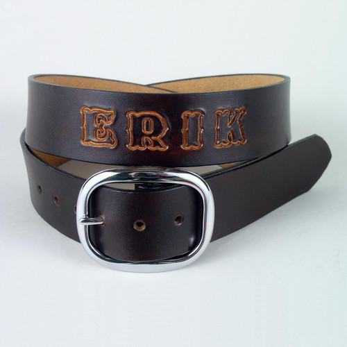 Custom handmade belt personalized with tooled name in a natural undyed leather color.