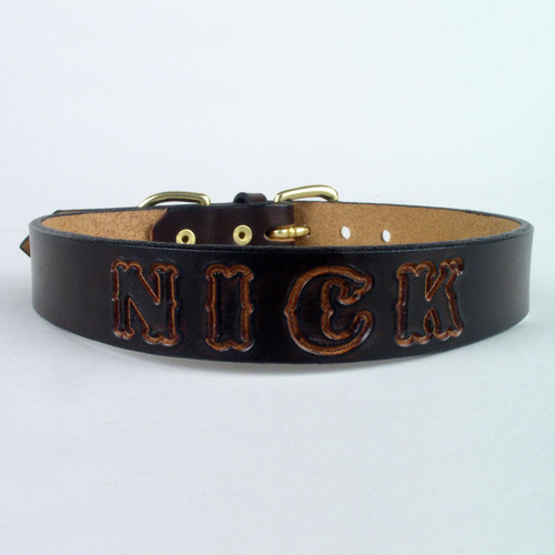 Custom dog collar made of solid leather and imprinted name shown in undyed lettering.