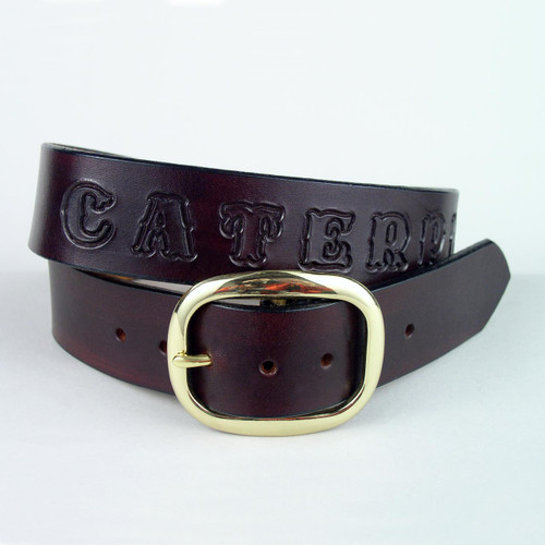 Custom leather name belt with hand tooled letters dyed in the same color as the leather.