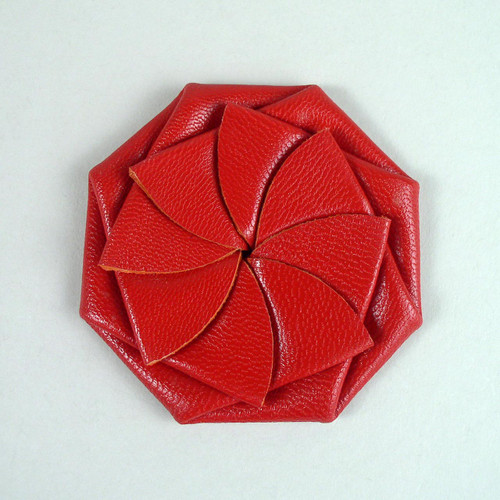 Red leather squeeze coin purse for pocket.