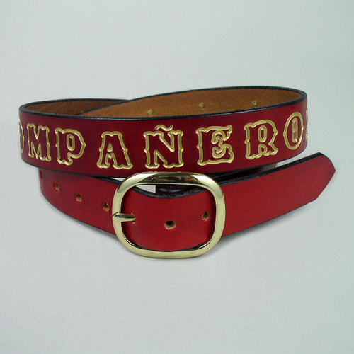 The belt lettering was first stamped deep in the leather and then hand painted in gold color against this red leather.