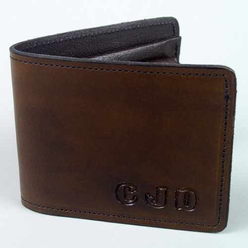 Personalized wallet with letters dyed in the same color of the leather a for subtle look.