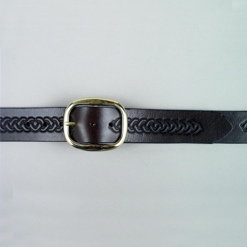 Solid brass buckle on embossed solid leather belt.